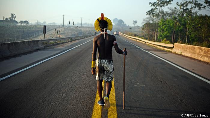 A Kayapo person protesting a highway that is enabling deforestation (AFP/C. de Souza)