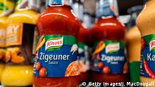 Bottles of Zigeuner Sauce (Gipsy Sauce) by German food maker Knorr are on display at a supermarket in Berlin on August 17, 2020. - German food maker Knorr said Monday it would change the name of its popular gypsy sauce to something less offensive, becoming the latest global company to respond to complaints about racist branding. The so-called Zigeunersauce (German for gypsy sauce) will soon be sold as Hungarian-style paprika sauce, Knorr's parent company Unilever said in a statement sent to AFP. (Photo by John MACDOUGALL / AFP) (Photo by JOHN MACDOUGALL/AFP via Getty Images)