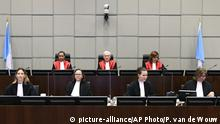 Presiding Judge, Judge David Re, top centre, with Judge Janet Nosworthy, left, and Judge Micheline Braidy, during a session of the United Nations-backed Lebanon Tribunal in Leidschendam, Netherlands Tuesday Aug. 18, 2020, where it is scheduled to hand down it's judgement in the case against four men being tried for the bombing that killed former Lebanon Prime Minister Rafik Hariri and 21 others. The U.N.-backed tribunal in the Netherlands is to deliver verdicts in the trial held in absentia of four members of the militant Lebanese Hezbollah group accused of involvement in the 2005 truck bomb assassination of former Lebanese Prime Minister Rafik Hariri. (Piroschka Van De Wouw/Pool via AP) |