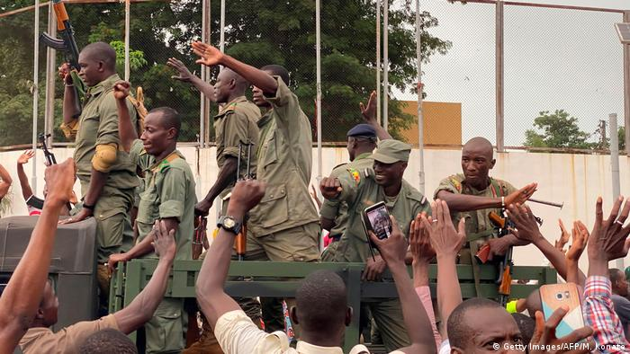 Soldiers are celebrated by a crowd of anti-government demonstrators in capital Bamako