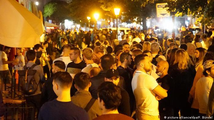 Hamburg Reeperbahn crowds mingle despite the coronavirus pandemic