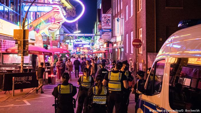 Hamburg Reeperbahn police officers patrolling visitors during the coronavirus crisis