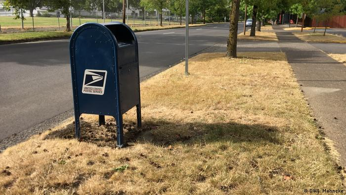 A public mail collection box with the USPS logo on the side