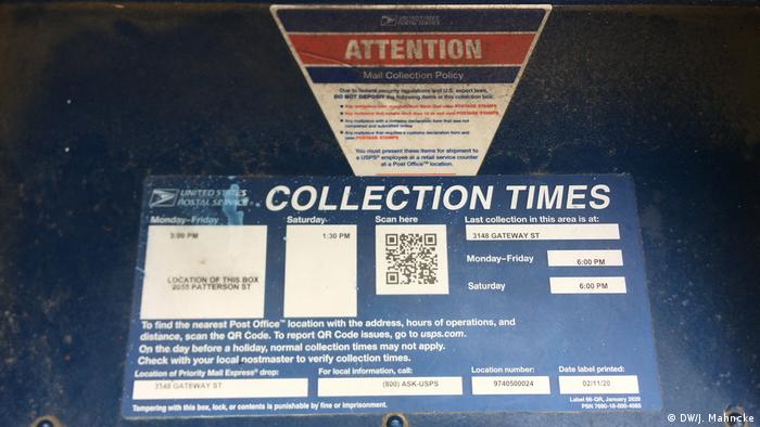 A USPS mailbox shows its collection hours