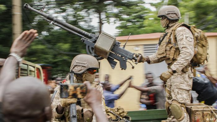 Malian soldiers celebrate their takeover at Independence square in Bamako