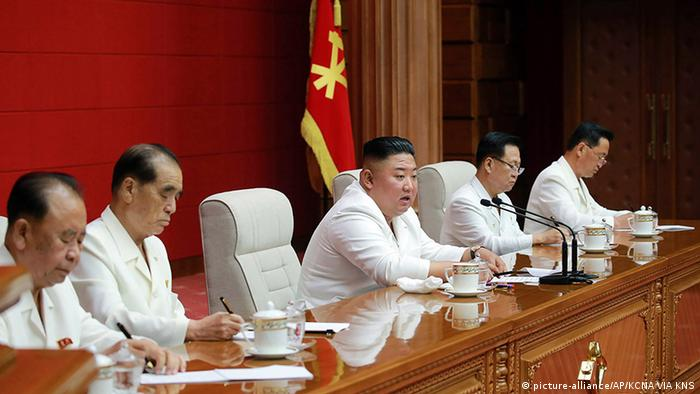 Kim Jong Un, center, attends a plenary meeting of the Workers' Party