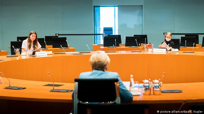 Angela Merkel in the conference room with Neubauer and Thunberg