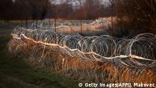 A barbed wire fence is seen at the Slovenian-Croatian border, near the village of Veliki Obrez, in Slovenia on February 16, 2017. Slovenia on January 26, 2017 approved a bill allowing police to seal the border with Croatia to migrants in case of a new influx along the so-called Balkan route, sparking condemnation from rights groups. Under the new legislation, Slovenian authorities can reject asylum seekers directly at the frontier with non-Schengen member Croatia if migrant numbers suddenly rise and threaten public order and internal security. / AFP / Jure MAKOVEC (Photo credit should read JURE MAKOVEC/AFP via Getty Images)