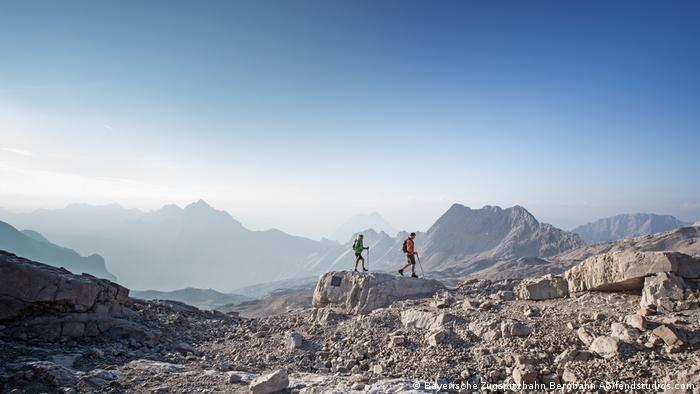 Germany, Bavaria, Zugspitze - two mountaineers hiking in summer