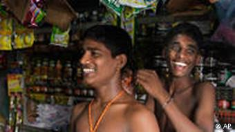 Two Tamil brothers prepare garlands for New Year
