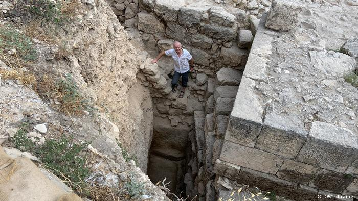 The German archaeologist Dieter Vieweger stands inside an excavation on Mount Zion