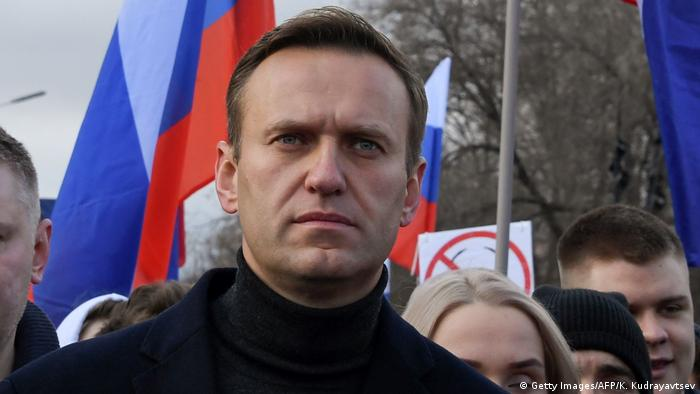 Russian opposition leader Alexei Navalny, his wife Yulia, opposition politician Lyubov Sobol and other demonstrators take part in a march in memory of murdered Kremlin critic Boris Nemtsov in downtown Moscow on February 29, 2020.