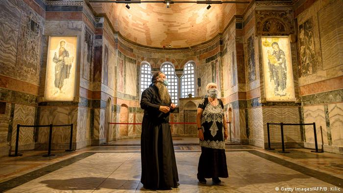 A priest and a woman visit the Chora Museum, formally the Church of the Holy Saviour, a medieval Byzantine Greek Orthodox church, on August 21, 2020 (Getty Images/AFP/B. Kilic)