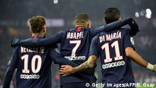 TOPSHOT - Paris Saint-Germain's French forward Kylian Mbappe (C) is congratulated by Paris Saint-Germain's Brazilian forward Neymar (L) and Paris Saint-Germain's Argentine midfielder Angel Di Maria after scoring a goal during the French L1 football match between Paris Saint-Germain (PSG) and FC Nantes (FCN) at the Parc des Princes in Paris, on December 4, 2019. (Photo by Bertrand GUAY / AFP) (Photo by BERTRAND GUAY/AFP via Getty Images)