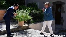 French president Emmanuel Macron (L) welcomes German Chancellor Angela Merkel as she arrives at Fort de Bregancon, in Bormes-les-Mimosas, south-east of France, on August 20, 2020. - French president Emmanuel Macron met German Chancellor Angela Merkel to try to strengthen the understanding of the Franco-German couple on the many hot European and international issues. (Photo by Christophe SIMON / POOL /ABACAPRESS.COM |