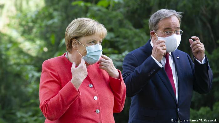Angela Merkel with NRW state's Armin Laschet