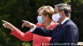 BG I Wie mit Fotos Politik gemacht wird I Virus Outbreak Germany Merkel