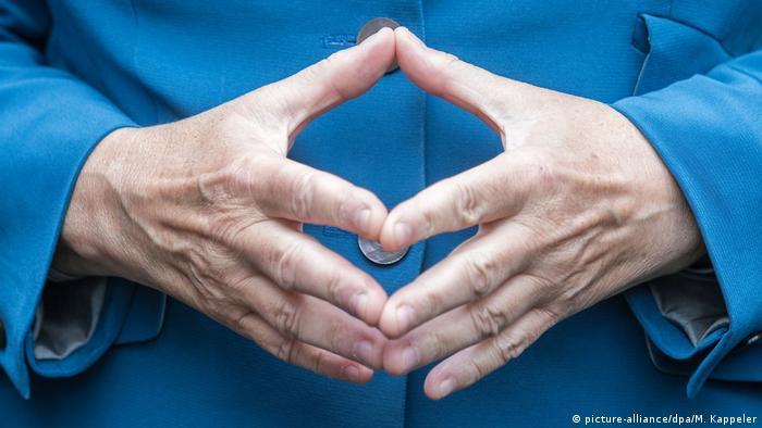 Angela Merkel's hand gesture
