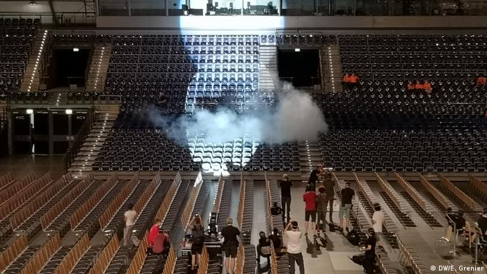 A cloud of smoke in a largely empty stadium