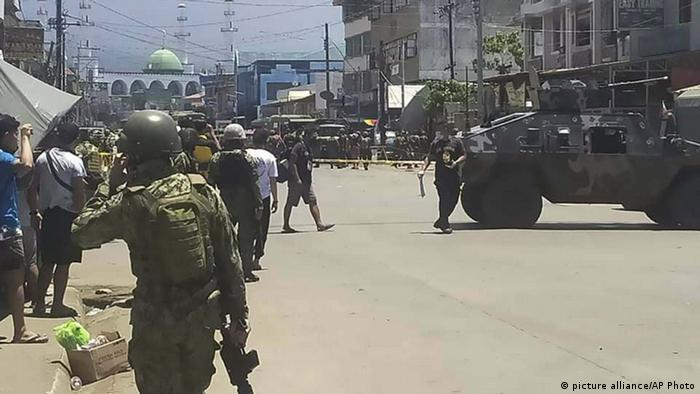 troopers secure an area after two explosions struck the town of Jolo