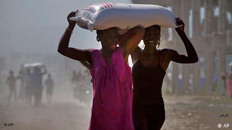 Women carrying bags of rice on their heads in Port-au-Prince in March 2010 (AP)