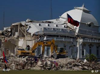 Bulldozers at work at the earthquake damaged presidential palace in Port-au-Prince