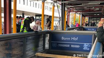 ines being handed out at Bonn train station
