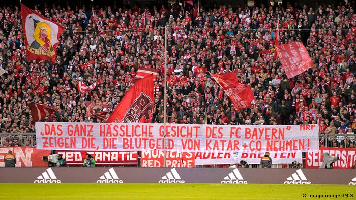 A protest banner by Bayern Munich fans against their club's sponsorship deal with Qatar.
