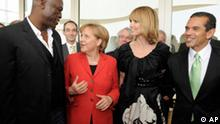 German Chancellor Angela Merkel, second from left, and Los Angeles Mayor Antonio Villaraigosa, right, pose for a photo with German model Heidi Klum, and her husband Seal, left, during a luncheon at the Getty Center in Los Angeles Wednesday, April 14, 2010. (AP Photo/Paul Buck, pool)