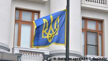 The Presidential flag flies at half mast outside Kiev's Presidential office on February 22, 2014. Ukraine's embattled President Viktor Yanukovych has left Kiev, opposition leader Vitali Klitschko said on February 22, amid reports that the president has fled the country altogether following a week of deadly violence. He has left the capital, Klitschko told parliament, also calling for early presidential elections before May 25. AFP PHOTO/ SERGEI SUPINSKY (Photo credit should read SERGEI SUPINSKY/AFP via Getty Images)