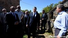 Croatian President Zoran Milanovic (C) and Deputy Prime Minister and Minister of War Veterans Tomo Medved (L) visits the ruins of homes where was the mass murder of six Serb civilians 25 years ago in the aftermath of Operation Storm, in the village of Grubori, near the town of Knin, on August 25, 2020, - For the first time in 25 years, Croatian authorities are taking part in a commemoration in Plavno and Grubori, places where Serb civilians were killed. (Photo by Denis LOVROVIC / AFP)