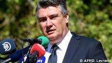 Croatian President Zoran Milanovic delivers his speech during the commemoration of the 25th anniversary of the killings of six Serb villagers, in the village of Plavno, near Knin in southern Croatia on August 25, 2020. - For the first time in 25 years, Croatian authorities are taking part in a commemoration in Plavno and Grubori, places where Serb civilians were killed. (Photo by Denis LOVROVIC / AFP)