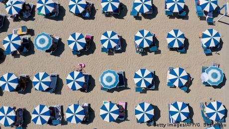 Sun umbrellas on a beach in Albania