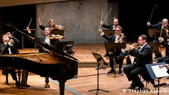Berlin Philharmonie: June 20, 2020: String players, a trumpeter and a pianist onstage