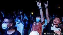 Fans attend a night of heavy metal concerts at Omni Space following an outbreak of the coronavirus disease (COVID-19) in Beijing, China, August 14, 2020. Picture taken August 14, 2020. REUTERS/Thomas Peter