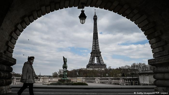 The Eiffel Tower in Paris, seen from under a nearby bridge