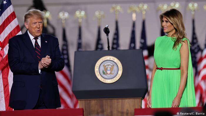 .S. President Donald Trump claps hands near of U.S. first lady Melania Trump