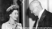 HM Queen Elizabeth II shakes hands with US president Dwight Eisenhower as the latter arrived at the British Embassy in Washington for the dinner given in her honour during the official visit to the American capital. 22nd October 1957 Great Britain / Mono Print  