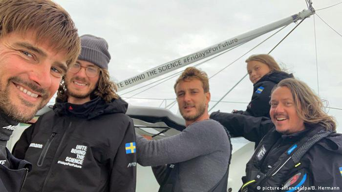 Film crew with climate activist Greta Thunberg aboard a sailboat (picture-alliance/dpa/B. Hermann)