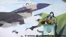 """Taiwanese President Tsai Ing-wen delivers a speech as she inaugurates an F-16 maintenance center at the Aerospace Industrial Development Corp. (AIDC) in Taichung, central Taiwan, Friday, Aug. 28, 2020. Amid rising threats from China, Tsai on Friday said the self-governing island was determined to strengthen its defenses. Tsai said Taiwan wanted to """"let the world to see our strong will in protecting the country."""" (AP Photo/Chiang Ying-ying) 