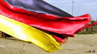 A German flag waving on a tank