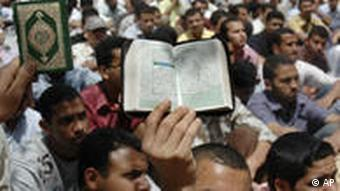 Muslim Brotherhood students hold a copy of the Quran during protests