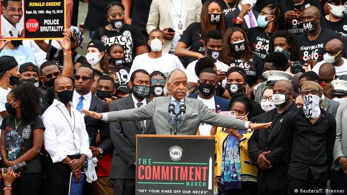 Rev. Al Sharpton addresses the Get Your Knee Off Our Necks Commitment March