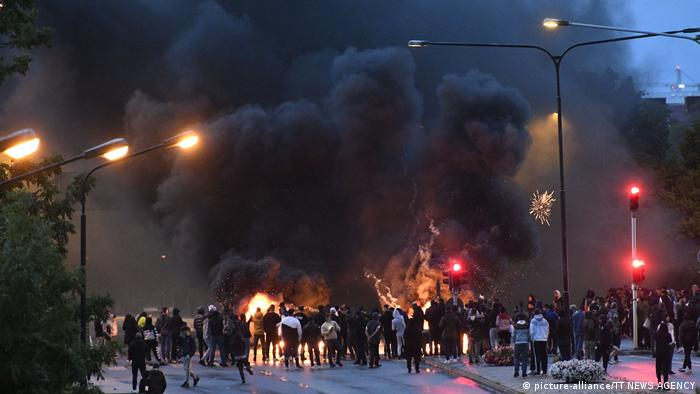 Smoke from burning tires can be seen as protests erupt in Sweden