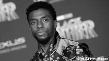 (FILES) In this file photo taken on January 29, 2018 Actor Chadwick Boseman attends the world premiere of Marvel Studios' Black Panther, in Hollywood. - Chadwick Boseman, the star of the ground-breaking superhero movie Black Panther, has died from colon cancer, his publicist told AFP August 28. Boseman, who was in his 40s, had not publicly discussed his condition -- which was first diagnosed in 2016 -- and continued to work on major Hollywood films. (Photo by VALERIE MACON / AFP)