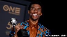 FILE PHOTO: 50th NAACP Image Awards – Photo Room – Los Angeles, California, U.S., March 30, 2019 – Chadwick Boseman poses backstage with his Outstanding Actor in a Motion Picture award for Black Panther. REUTERS/Mike Blake - HP1EF3V08CN00/File Photo