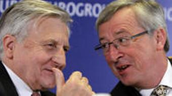 Luxembourg's Finance Minister Jean Claude Juncker, right, speaks with European Central Bank President Jean Claude Trichet during a media conference after a meeting of eurozone finance ministers in Madrid, on Friday, April 16, 2010. Debt-laden Greece has asked for more talks about a financial rescue plan put together by eurozone countries and the International Monetary Fund. (AP Photo/Virginia Mayo)
