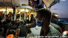 Migrants are pictured onboard the Sea-Watch 4 civil sea rescue ship off the coast of Malta on August 27, 2020. - The Sea-Watch 4 is seeking for a safe harbour for its passengers. Within 48 hours, the crew of the Sea-Watch 4 has rescued more than 200 people. (Photo by Thomas Lohnes / AFP) (Photo by THOMAS LOHNES/AFP via Getty Images)