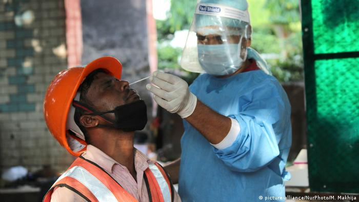 A health worker collecting a nasal swab of a patient in New Delhi