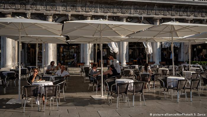 Empty out-door cafe tables on the Piazza San Marco